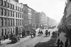George's Street, Limerick revisited (National Library of Ireland on The Commons) Tags: street ireland horses hotel 19thcentury flags posters ladder sidecars limerick awnings munster oconnellstreet glassnegative johnbass johncarr hatmaker georgesstreet gaslighting robertfrench seedsmen williamlawrence nationallibraryofireland jamesflynn edwardbaker horsedrawntransport aliceflynn lawrencecollection shawlies limerickbybeachcomber munsterset cruisesroyalhotel vaneesbeck francisvaneesbeck