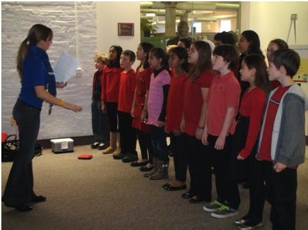 A choral group of fifth graders from an advanced program at Bailey's Elementary School in Falls Church, VA sing Christmas carols to Forest Service employees of the Yates Building for the Chief's holiday party on Monday, Dec. 6, 2010. Bailey's Elementary School is one of six partnership schools collaborating with Sustainable Operations to promote a sustainability ethic and enhance science curriculum for students. Photo by Maritza Huerta.