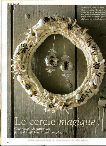 wreath made with cotton, buttons, cloth, and snaps