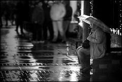 Woman at a Train Station in the Rain (greenthumb_38) Tags: california blackandwhite bw woman brick rain umbrella blackwhite waiting quiet bricks platform trainstation duotone orangecounty raining fullerton processed 70200mm waitingforatrain canonef70200mmf28l canon40d jeffreybass