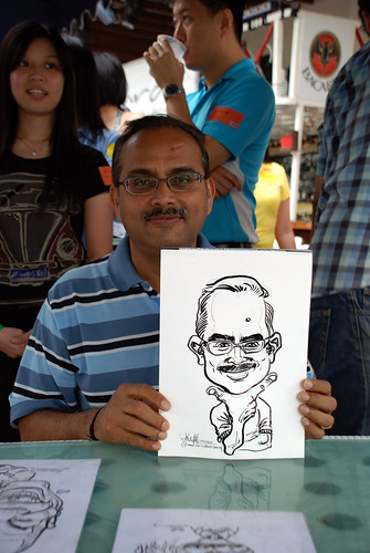 Caricature live sketching for VISA Beach Party 2010 -3