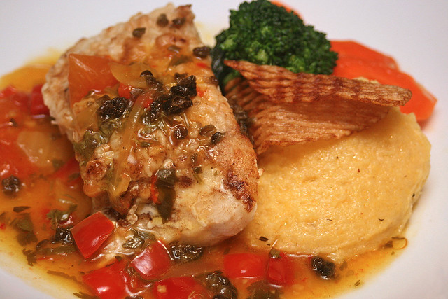 Golden Sea Bass: pan-seared and served on creamy black olive polenta, with Spanish sofrito and capers