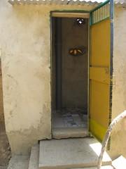 Inside view of the UDDT (Sustainable sanitation) Tags: construction mud pipe adobe blocks pan vault household slab burkinafaso squatting uddt