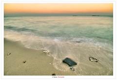 When The Waves Play With The Rocks (Damon | Photography) Tags: sunset sea sun seascape set photoshop high nikon dynamic angle wide sigma wideangle filter shore cs kuwait polarizer range damon hdr highdynamicrange circular onde circularpolarizer hoya q8 clp sigma1020mm d90 photomatix nikond90