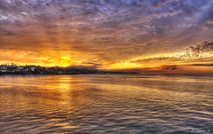 Breaking Out (Didenze) Tags: ocean light sunlight texture clouds sunrise reflections golden glow dramatic explore ripples sanclemente frontpage hdr sunbeams canon450d hdrspotting didenze