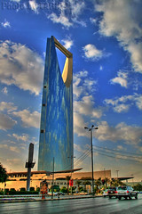 Kingdom Centre HDR- Explore (TARIQ-M) Tags: sky cloud building car architecture cityscape desert business riyadh saudiarabia hdr app canonefs1855 kingdomtower  kingdomcentre   burjalmamlaka  canon400d   tariqm   tariqalmutlaq kingofdesert 100606169424624226321postsnajd12sa