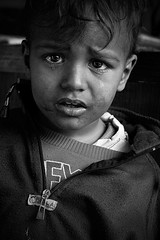Tears (Ibrahim Almulhim ) Tags: street bw canon kid child poor egypt streetphotography canonef2470mmf28lusm canoneos50d poverity ibrahimalmulhim