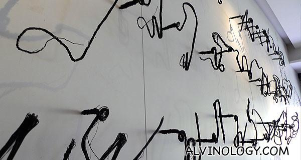 Thai alphabets as wall decor - they case nice symmetrical shadows