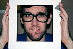 Qurette (Cayo C.) Tags: wallpaper portrait man male guy face beard glasses hands framed fear hipster young handsome biting frame bite scared gaze lowerlip