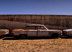 how do i get out? (Maureen Bond) Tags: ca longexposure windows cars abandoned glass wall night stars shadows desert stuck rusty fullmoon dirt junkyard crusty corvair tailights doorhandles behindthewall 3cars 2doors cantgetout maureenbond