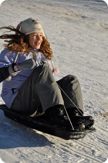 Sledding at Westboro Beach