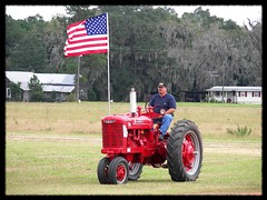 Flag over a Farmall (Dusty_73) Tags: park old lake tractor america vintage georgia stars pull farm glory stripes flag m equipment international american ag agriculture harvester farmall ih mccormick