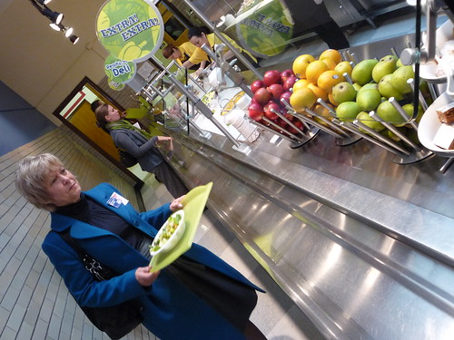 Christie Vilsack samples a healthy, made-to-order salad from Von Steuben High School's revamped cafeteria line.