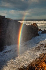 Rainbow in the Surf (Jeffrey Sullivan) Tags: ocean california sunset copyright usa canon photo rainbow surf pacific january southern blowhole allrightsreserved 2011 jeffsullivan