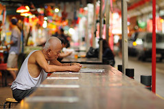 Lottery [Explored] (B.Image357) Tags: colors festival reading nikon singapore chinatown faces bokeh f14 candid streetphotography 85mm lifestyle oldman lottery cinematicmoments d90 peopleinthecity flickraward nikonflickraward sigma85mmf14exdghsm