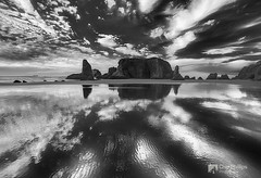 Black and White Cloud Reflections, Bandon Oregon (Chip Phillips) Tags: ocean winter sea bw white black monochrome face rock clouds oregon reflections mono coast pacific northwest bandon stacks monoliths