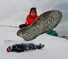 Dude! Jump Over Me! (Christopher Brian's Photography) Tags: winter snow toronto cold boys kids fun jump waterfront beaches sledding waterworks skidoo sportsphotography wintersports actionphotography rcharriswaterfiltrationplant canoneos7d tokina1116mmf28 hpcwinterwonderland