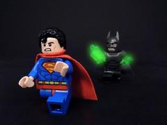 Pranking with Kryptonite (MrKjito) Tags: lego minifig super hero superman batman kryptonite stone weakness power suit prank bruce wayne clark kent