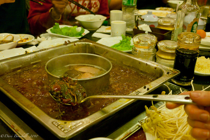 spoonful of hot spices in a sichuan hot pot