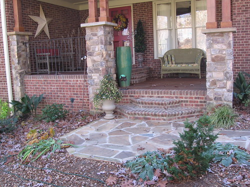brick porch flanked with stone columns on a home in southwest Raleigh, North Carolina
