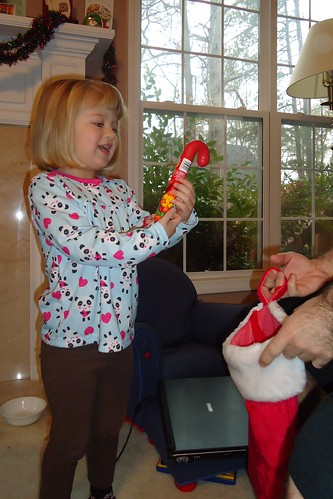 Catie checking out her stocking on Christmas morning
