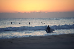 Dawn waves (Smackthatbird) Tags: ocean christmas winter beach sports beautiful sunrise nikon colorful december waves florida surfer silhouettes westpalmbeach stuart atlantic telephoto surfers jupiter 70200 juno junobeach greatlighting d3s nikond3s