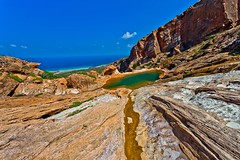 swimming pool in natural rock at homhill, Soqotra Island, UNESCO, yemen (anthony pappone photography) Tags: pictures travel nature digital canon lens landscape island photography photo foto image picture natura unesco arab arabia adan yemen arabian fotografia bottletree paesaggio reportage photograher arabo yemeni phototravel yaman socotra soqotra arabie arabiafelix arabieheureuse اليمن arabianpeninsula يمني 也門 سقطرى сокотра alyaman yemenpicture yemenpictures 索科特拉 ソコトラ सोकोट्रा dragonsbloodtrees