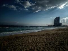 Barcelona beach with the vela hotel