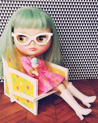 Sally enjoys an ice cream as she sits in one of the prototypes of the chair we may be introducing to the Endangered Sissy retro-repertoire soon. It's a flat-pack design (think IKEA for dolls) that requires no adhesives to assemble. What do you think?