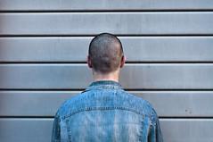 SA FE (MaraFemia) Tags: ferrara italy portrait antiportrait head man jeans wall walls street architecture texture back neck ears shaved shoulders sun