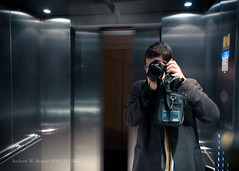 Exit (322/365) (andrewrennie) Tags: camera portrait selfportrait man blur metal scarf bag lights mirror hands nikon shiny doors lift metallic elevator jumper opening exit d90 project365 nikond90 321365