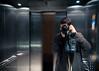 Exit (322/365) (andrewrennie) Tags: camera portrait selfportrait man blur metal scarf bag lights mirror hands nikon shiny doors lift metallic elevator jumper opening exit d90 project365 nikond90 321365