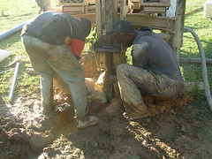Gravelling the well during drilling process at Ebusyubi Primary School