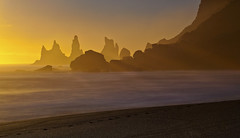 Vik Sunset (antonyspencer) Tags: ocean sunset sea mist beach landscape iceland spray stack vik rays volcanic stacks crepuscular