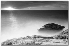 shine in new splendor (chris frick) Tags: longexposure sunset sea blackandwhite bw sun storm rocks raw tripod wideangle textures filter rays rough drama mallorca mediterraneansea 154 cokin lensflares 121s a550 remoteshuttercontrol chrisfrick bensdavall sonyalpha550 shineinnewsplendor