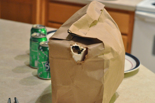 Hungry Kitty Chews through bag of Chinese Food
