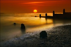 Sunrise at Whitstable (adrians_art) Tags: longexposure beach sunrise reflections coast kent waves tide pebbles shore northsea whitstable groynes seawater