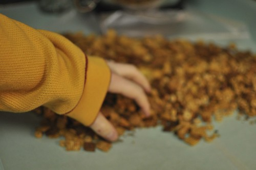 reaching for the chex mix