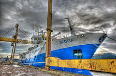 Scotia (elementalPaul) Tags: blue sky white yellow clouds scotland dock edinburgh ship pentax crane tripod leith scotia hdr sigma1020mm photomatixpro 5xp k10d pentaxk10d leithdock