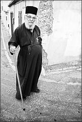 ..round the corner (-Filippos-) Tags: road street bw corner greek cyprus priest orthodox 2009 happynewyear larnaka kypros agios theodoros