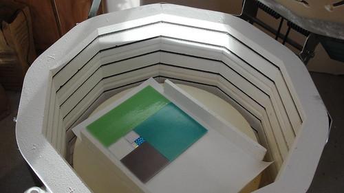 Photo of an assembled Fibonacci squares plate, inside a glass kiln
