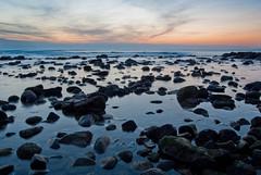 Gli spettatori (the_lighter) Tags: sunset sea roma nikon tramonto mare stones sassi riflessi spiaggia lazio onde santasevera scogli orizzonte d60 longexposition lungaesposizione platinumheartaward castellosantasevera