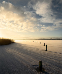 Sunrise over solid water (Dani℮l) Tags: winter snow holland ice netherlands sunrise landscape daniel sneeuw skating nederland cropped groningen januari paterswolde landschap ijs schaatsen d300 2011 paterwoldsemeer