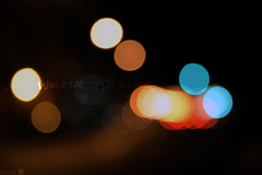 When the night has come (IsittaMagic) Tags: blue winter light red orange cold me azul by night canon luces noche stand rojo colorful bokeh colores invierno lennon naranja frio 1000 sandbyme