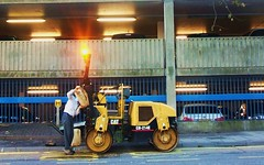 Man feeding a Cat water. Kingston 19/01/11 (Ledlon89) Tags: london water tarmac cat kingston roadrepairs roadroller constructionmachines alltypesoftransport catroadroller