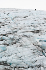 A hiker wearing crampons walks on the Harding Icefield. (Matt Wicks / GreatDistances) Tags: 2016 alaska d610 exitglacier hardingicefield kenaifjordsnationalpark kenaipeninsula nikon northamerica usa glacier ice nationalpark park