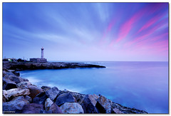 Augusta - Violet glow (ciccioetneo) Tags: santa italy lighthouse sunrise faro long exposure italia cross angle alba wide creative sigma commons holy filter creativecommons syracuse sicily augusta 1020mm sicilia siracusa croce hoya cokin nd400 nd8 p154 ciccioetneo