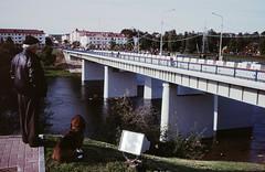 View over the river towards Orsha center (varjagg) Tags: leica dog 35mm cosina voigtlander 64 september 17 kodachrome kr belarus 2008 minsk asph m4 pagan postsoviet 7200  f17  ultron  lukashenko plustek exussr  opticfilm     dazhynki