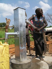 A girl pumps clean water