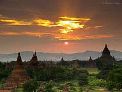 Sunset over Bagan ~ Myanmar (Burma) (Martin Sojka .. www.VisualEscap.es) Tags: travel blue sunset colors yellow clouds landscape gold golden evening pagoda asia purple burma vivid olympus myanmar zuiko bagan e5 1260 zd 1260mm